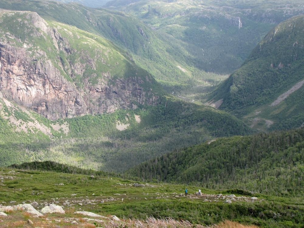 Two hikers seen in the distance on Gros Morne Mountain