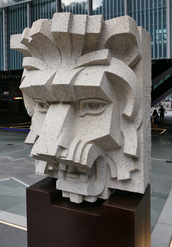 Angular stone lion head sculpture found at one of the bank buildings.