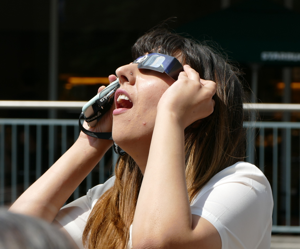 Woman watching the eclipse.