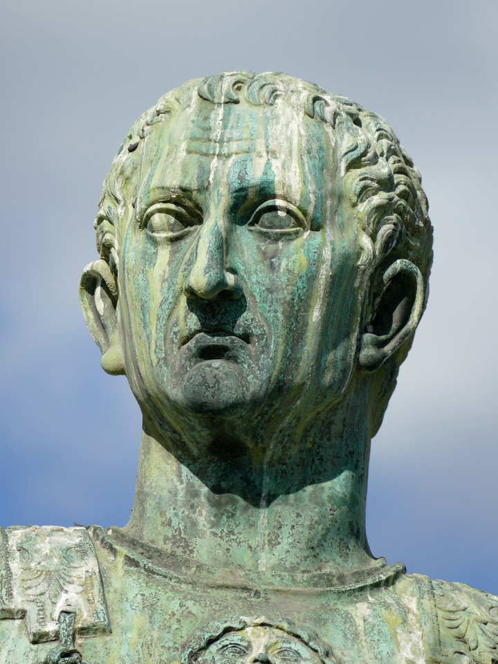 brass(?) sculpture of Caesar with discoloured green stripes