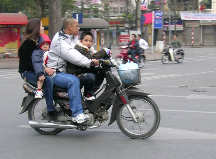 Two parents, two children, 100cc motorcycle.
