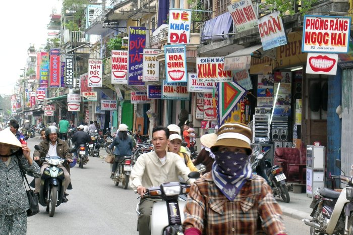 Street in Hué with lots of smile signage